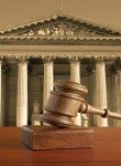gavel against background of a courthouse for skilled New Lenox family law attorneys